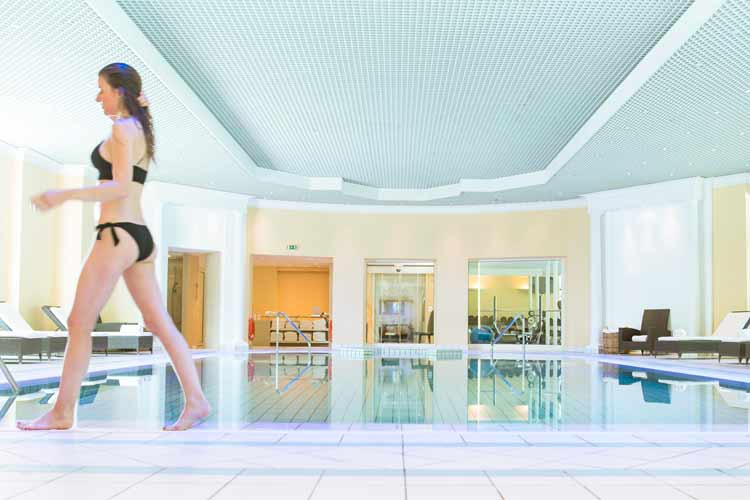 Royal Evian Hotel-Girl walking at the inside swimming pool