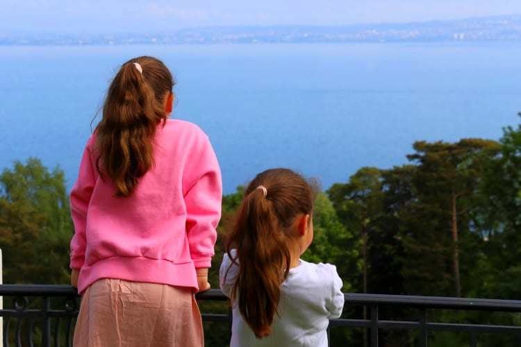 Mom and daughter looking at leman lake Royal Evian hotel