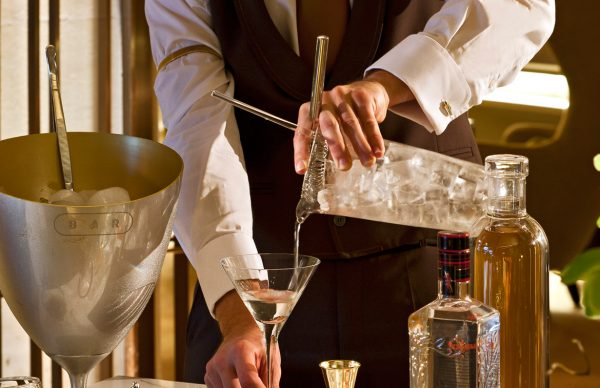Waiter serving a cocktail at Beau-Rivage Palace