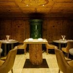 La Stube restaurant with ceilling and walls covered in wood at Cristallo Resort & Spa