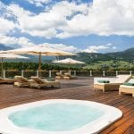 Terrace with hot tub and sun loungers at Cristallo Resort & Spa