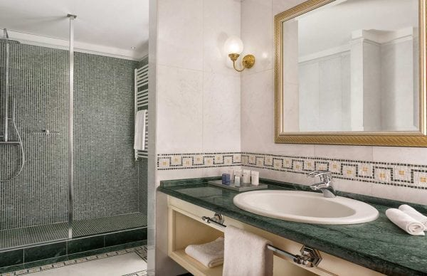 Bathroom with walk-in shower at Cristallo Resort & Spa