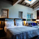 The bed of the Junior room at Jiva Hill Resort Golf & Spa