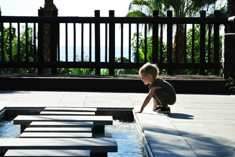 Kid playing and enjoying the sunny weather at Asia Gardens Hotel & Thai Spa
