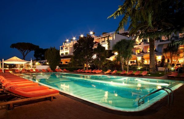 Outdoor pool at night at Capri Palace Hotel & Spa