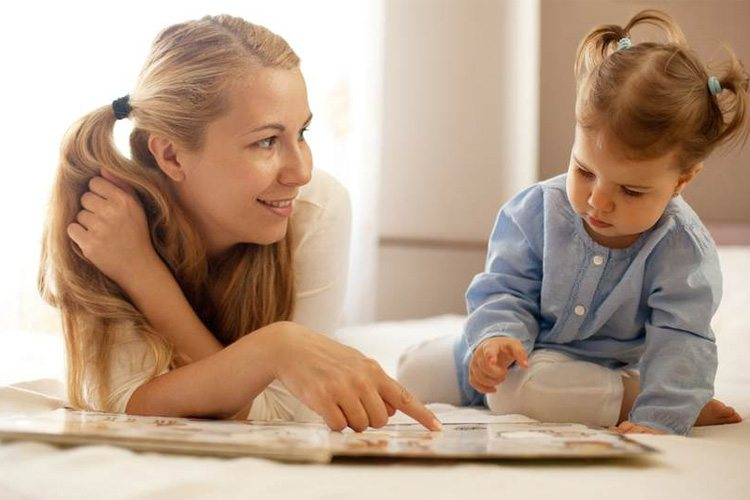 Family reading together at  Capri Palace Hotel & Spa