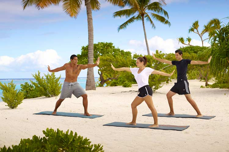 The Brando resort-yoga on the beach