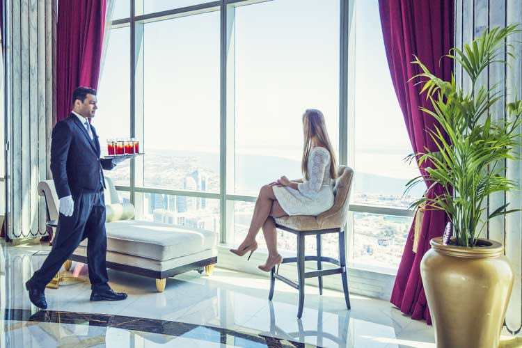 The St Regis Abu Dhabi Girl staring at the view
