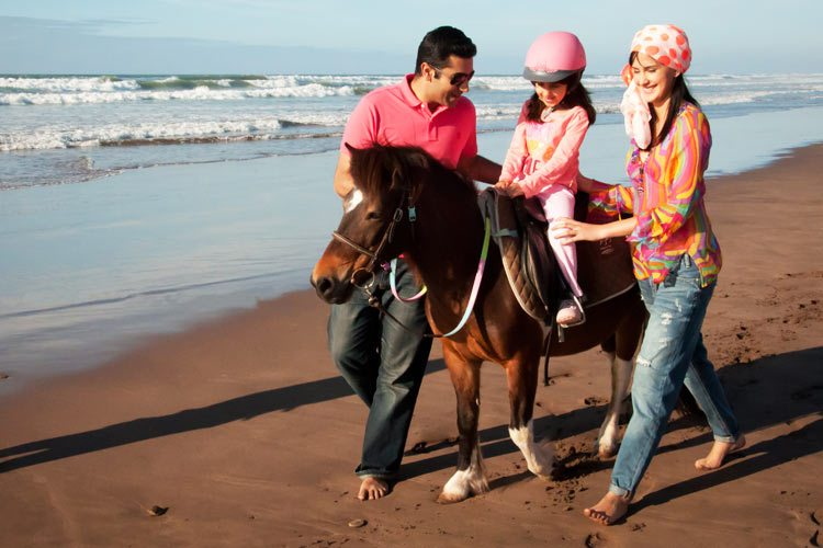 Mazagan Beach & Golf Resort Activity horse riding with the family on the beach