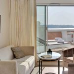 Double bedroom with living room and terrace at Grand Hôtel Thalasso & Spa