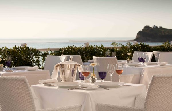 Outdoor restaurant terrace with sea view at Grand Hôtel Thalasso & Spa