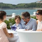 Family enjoying the outdoor terrace with se aview at Grand Hôtel Thalasso & Spa