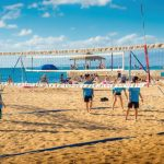 Kids playing volleyball by the beach near Grand Hôtel Thalasso & Spa