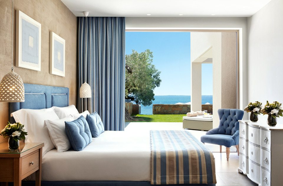 Bluish room with double beds with private garden at Ikos Olivia