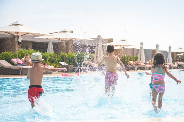 Ikos Olivia-kids runing in the pool