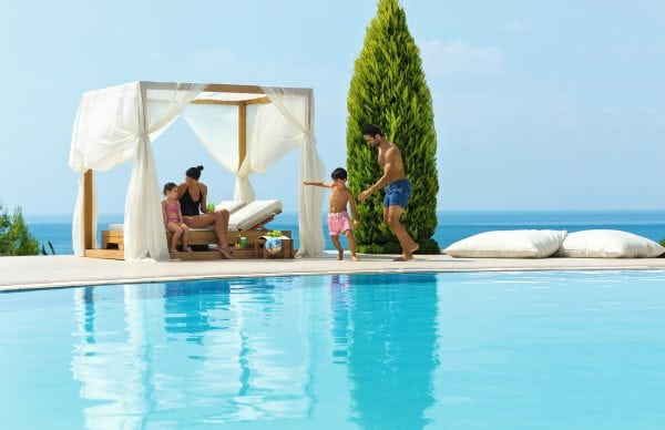 Family by the pool of Ikos Olivia