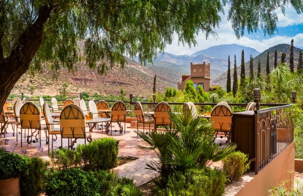 Outdoor terrace with a view of the vegetation at Kasbah Tamadot