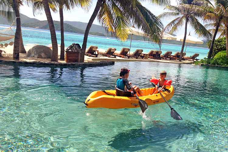 necker island kids kayak in the swimmin pool