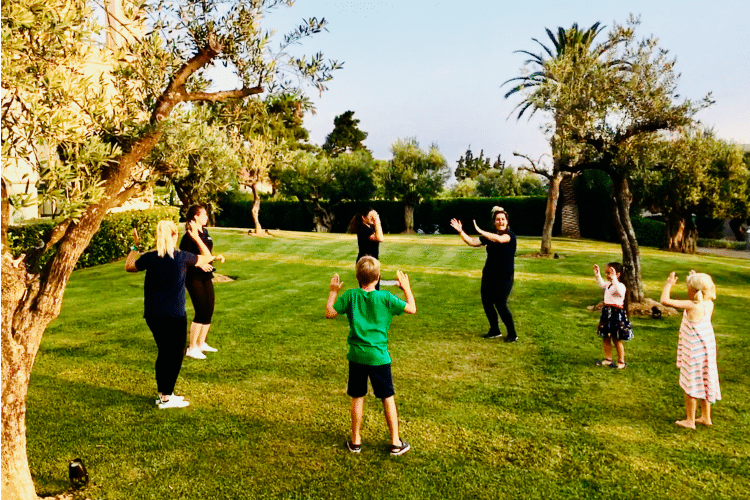 A sports class outside with the children and the animators of the kids club of Ikos Olivia