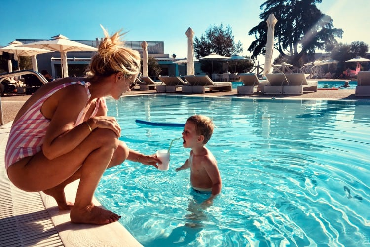 A mother and son in the Ikos Olivia pool