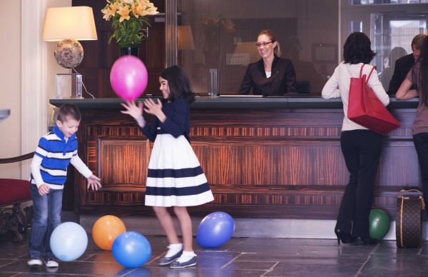Hotel Amigo Children playing with balloons