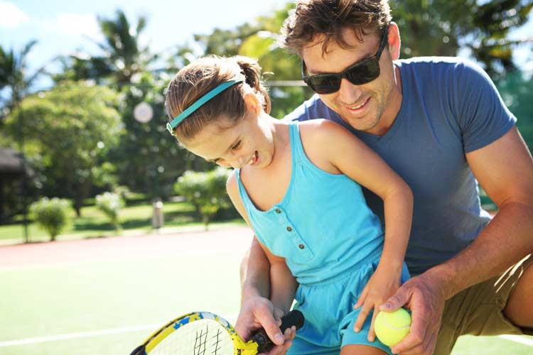 Lux Saint-Gilles-girl playing tennis with her dad