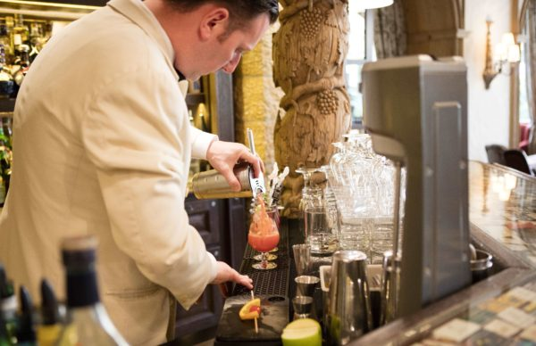 Waiter preparing a cocktail at Gstaad Palace