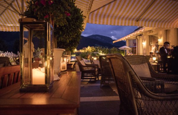 Gstaad Palace restaurant outdoor terrace by night