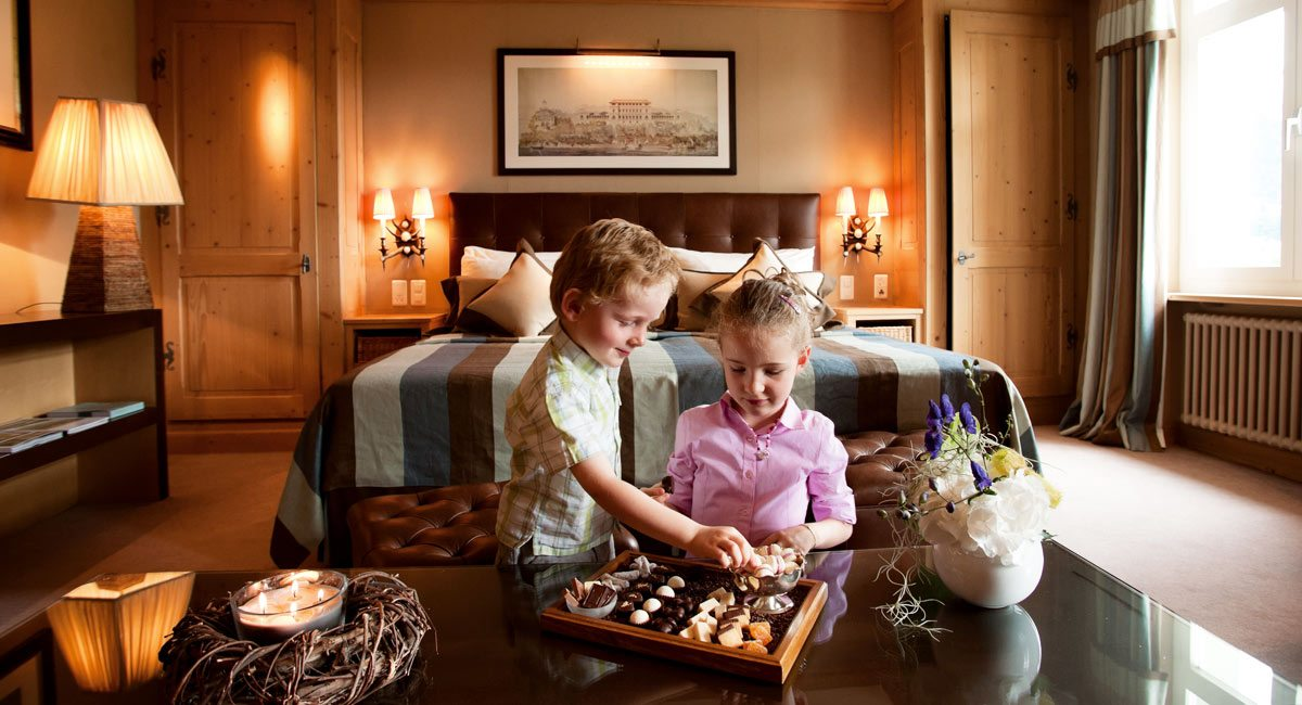 Gstaad Palace-kids eating chocolates in their hotel room