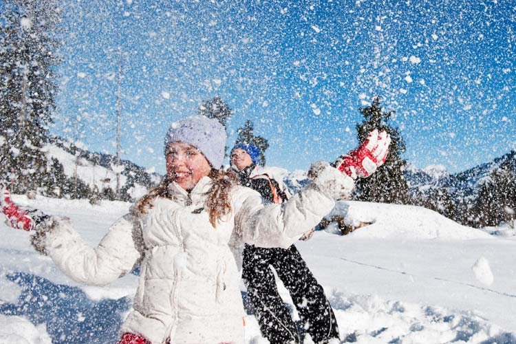 Gstaad Palace-children playing in the snow