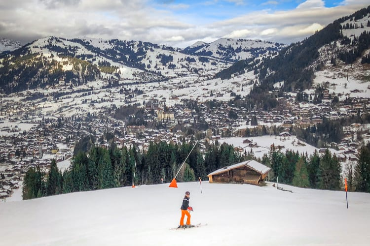 A man skiing in the Gstaad Palace surroundings