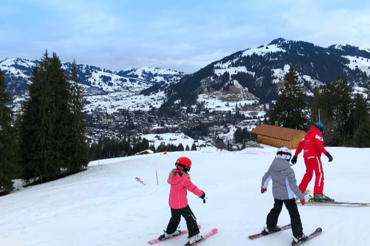 A family skiing in the Gstaad Palace surroundings