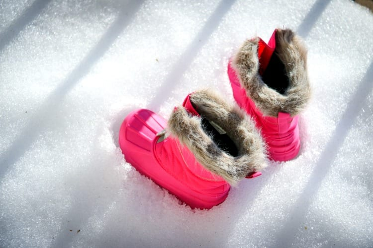 A little girl shoes in the snow