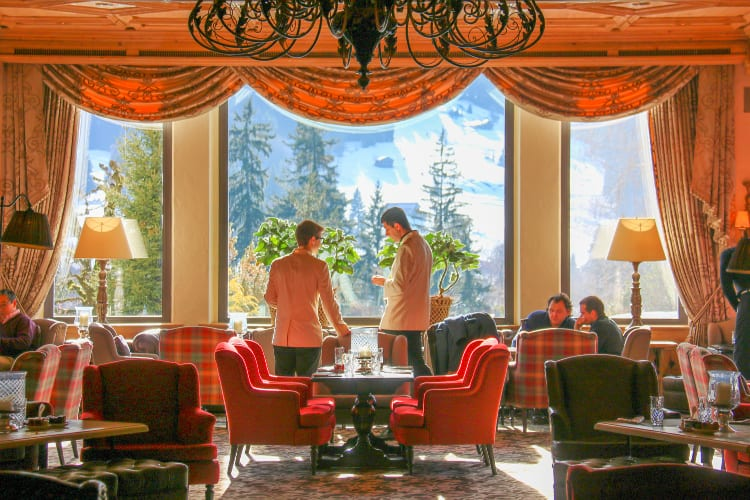 Two men talking at Gstaad Palace