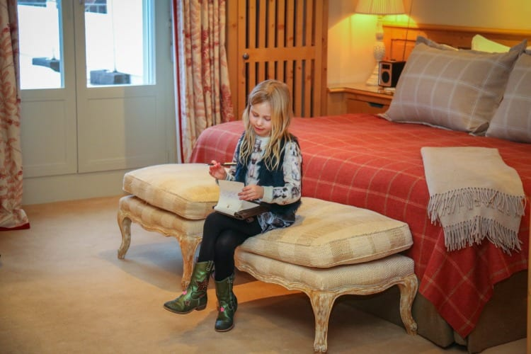 Little Girl reading in her room at Gstaad Palace