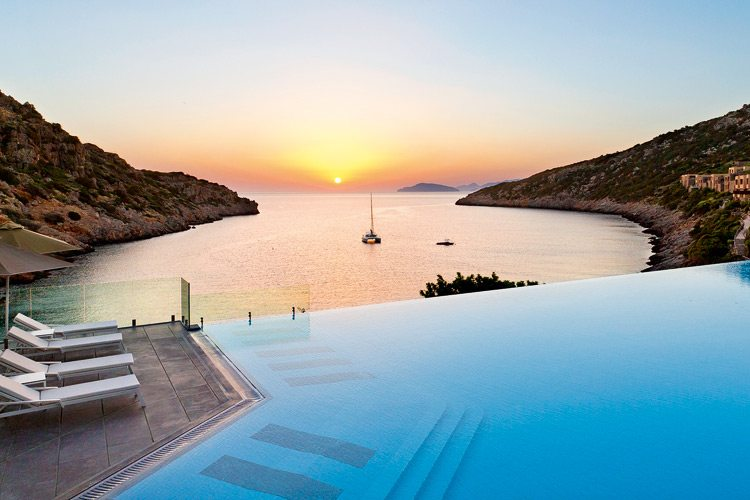 Pool with sea view and sunset Daios Cove