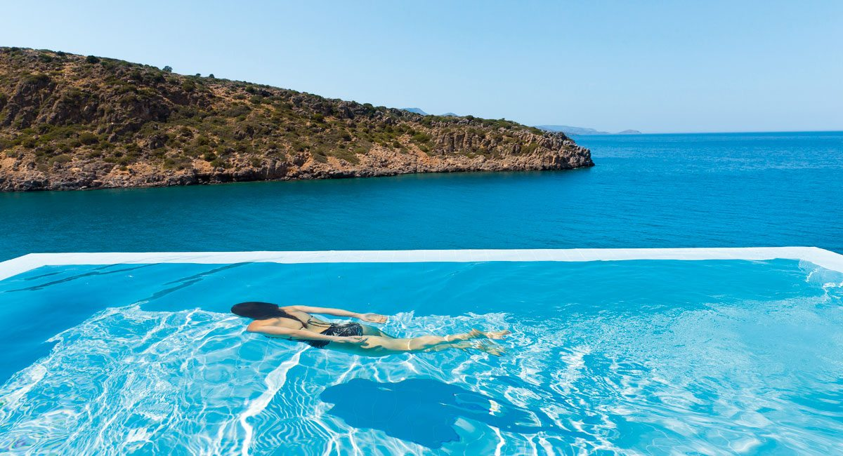 Daios Cove Hotel-woman swimming in private pool