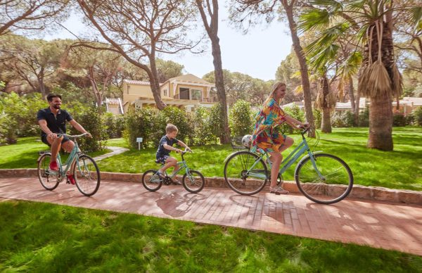 Family biking around Forte Village Resort