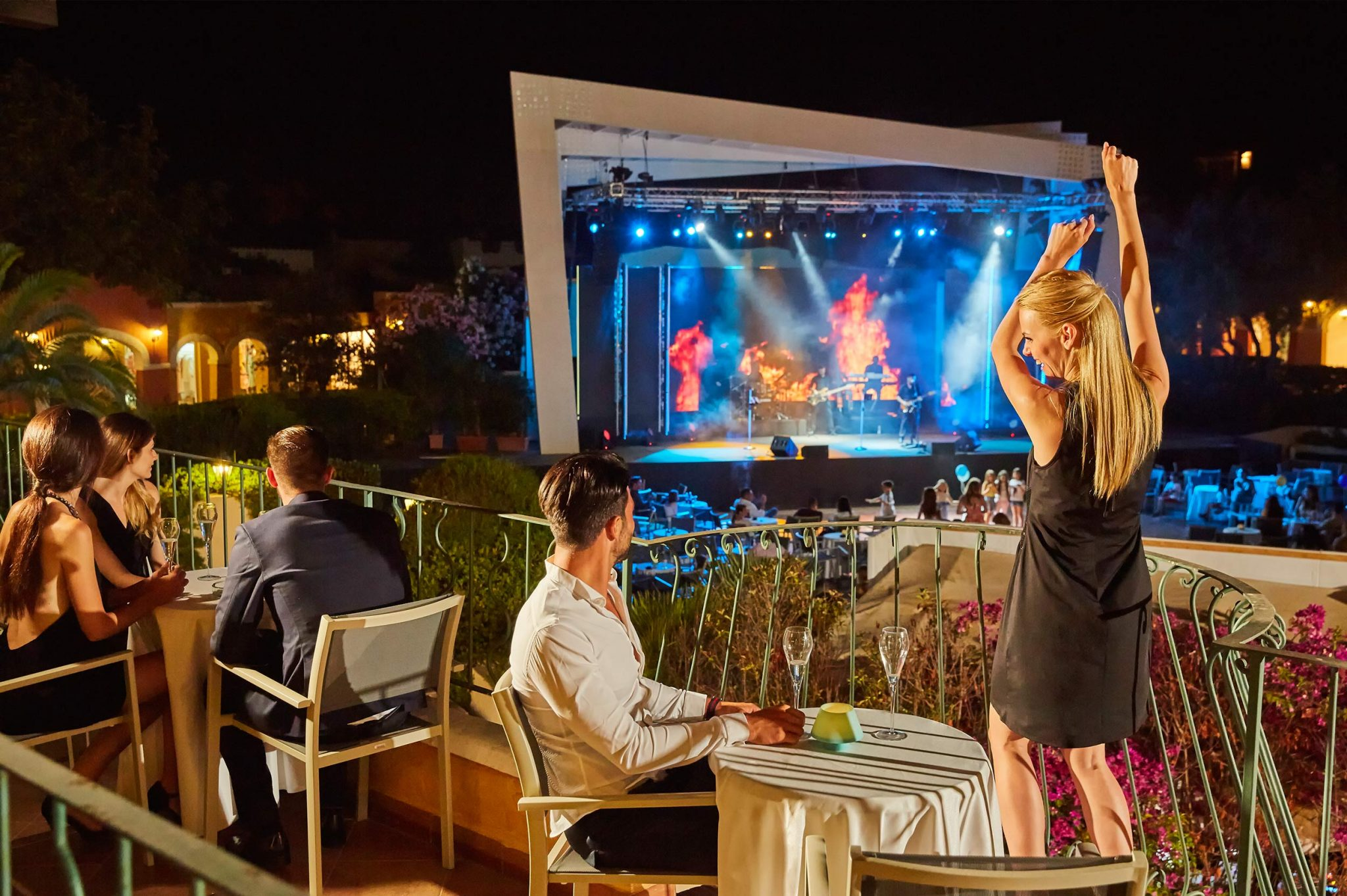 People enjoying a concert at Forte Village Resort