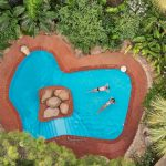 Swimming pool surrounded by garden at Forte Village Resort