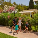 Family walking on the pathway at Forte Village Resort