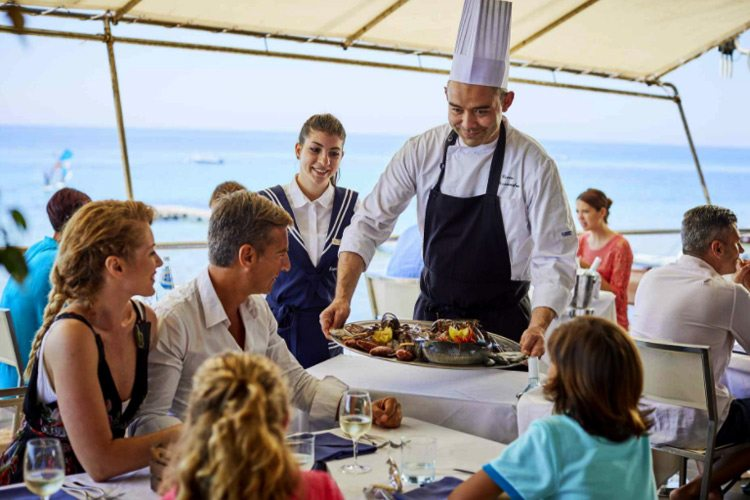 Chef presenting dish at Forte Village Resort