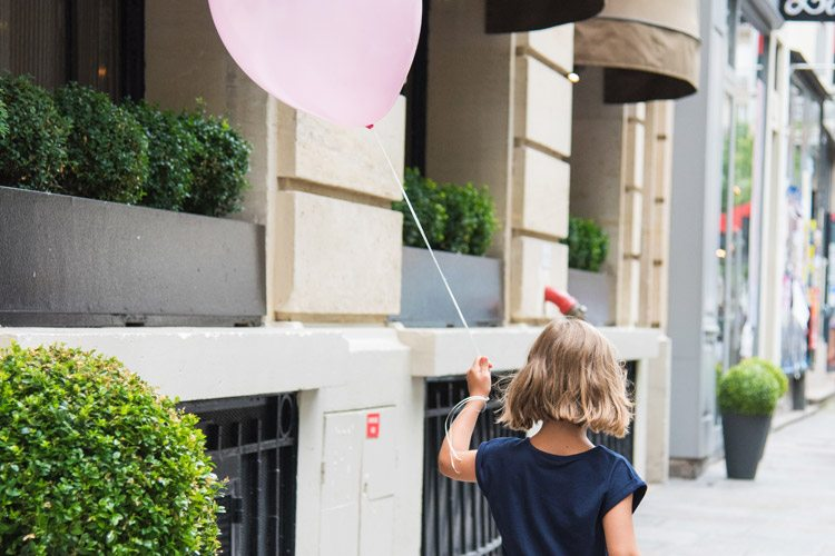 Little girl walking with a balloon