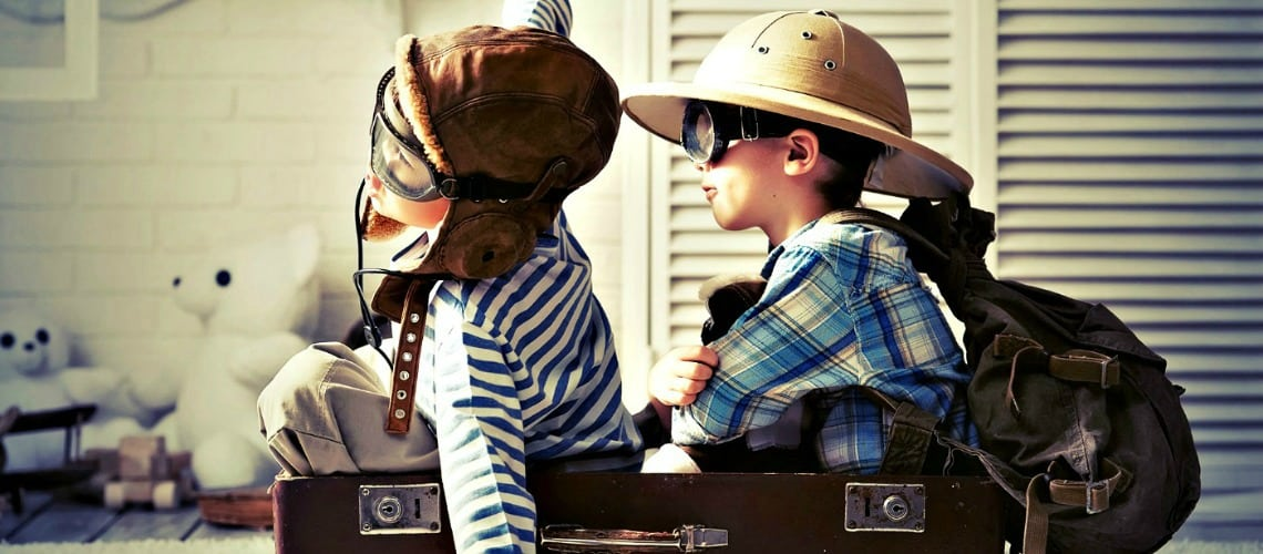 Two little boys play together in a suitcase the aviators and golddiggers