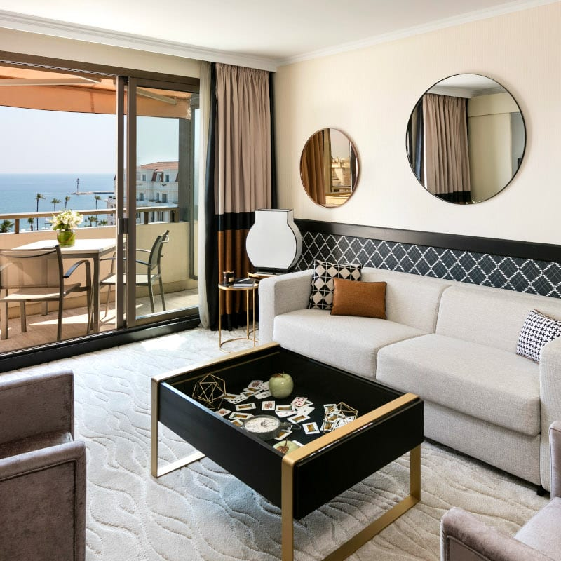 One bedroom in the Hotel Barrière Le Gray D'Albion Cannes