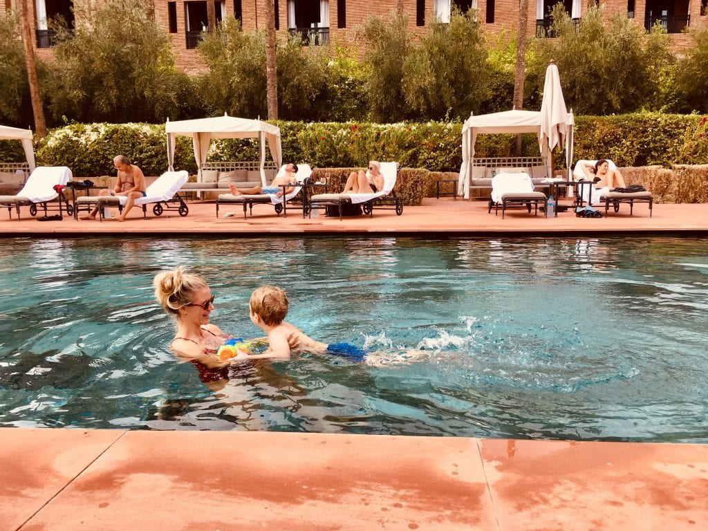 Hotel Selman Marrakech Mother and her child swimming in the pool