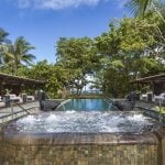 Shanti Mauritius Swimming pool with a jacuzzi