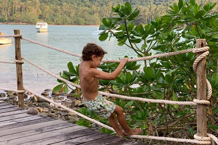 Kid plays in the garden of of the Soneva Kiri