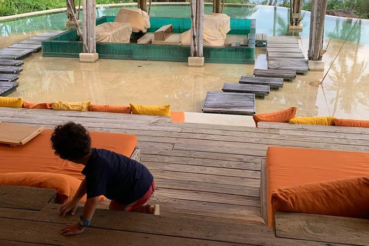 Kids plays near the outdoor pool of the Soneva Kiri
