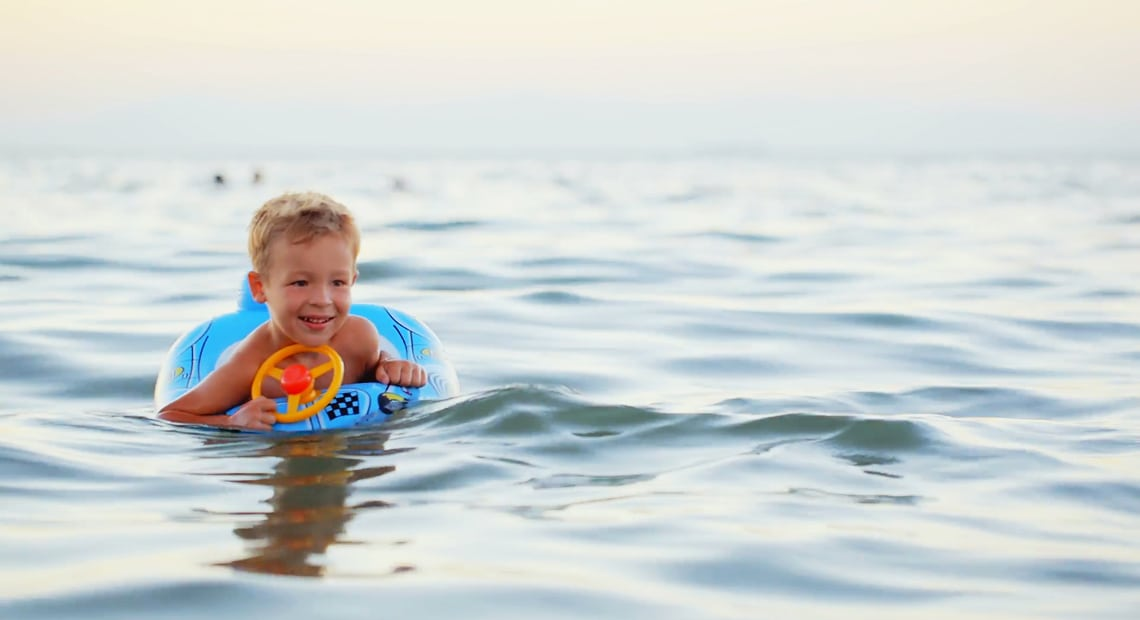 Little child swimming in the sea